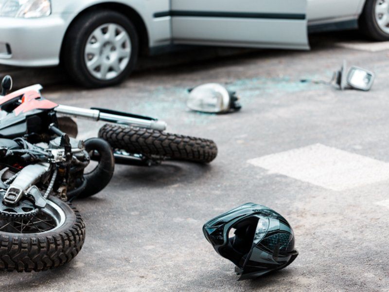 Motorcycle laying on roadway after collision